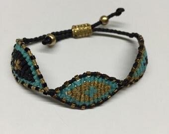 Black, gold and turquoise triple eye macrame bracelet