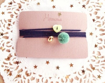 Bracelet with small bell and pom pom