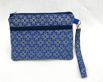 Wristlet purse. iphone wristlet. Blue and gold wristlet. Wristlet with keyring. Double zippered wristlet. Wristlet pouch