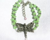 Fairy Bracelet, Multi Strand Bracelet, Apple Green Glass Beads with a Pewter Fairy and pink accent