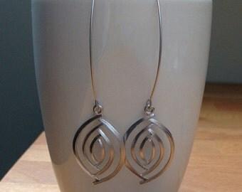 Matte silver oval eye earrings