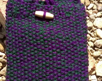Purple and green knitted pouch bag.
