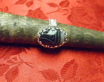 This ring is a banded agate size 6 1/2.