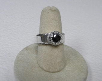This ring is a hematite  (8 mm)  size 6 3/4 .