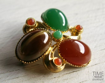 Vintage brooch with tree stones in gold tone