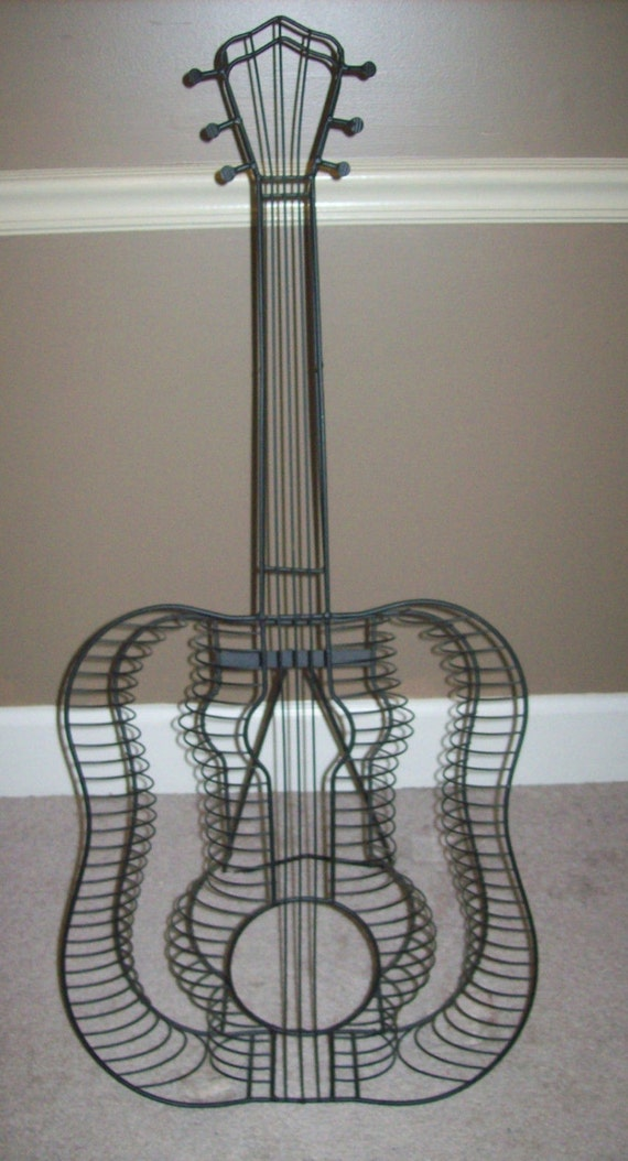 metal wire art deco guitar shaped cd rack holder. Black Bedroom Furniture Sets. Home Design Ideas