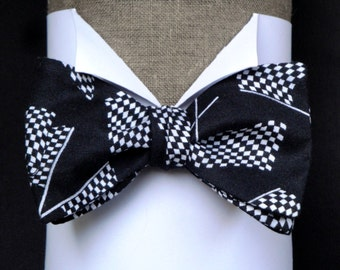 Chequered flags on black self tie or pre tied bow tie on an adjustable band.
