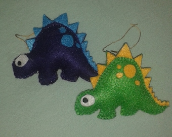 Handmade felt stuffed spotted dinosaur