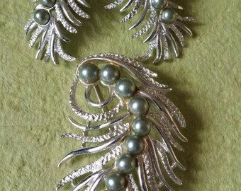 Sarah  Coventry vintage brooch and earring set.  silver tone with pearls. leafs.  clip on.