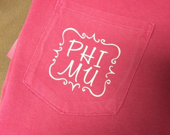 Phi Mu Quatrefoil Shirt offered on a variety of shirt styles!