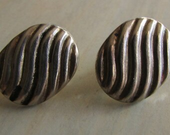Sterling Silver Post Earrings.