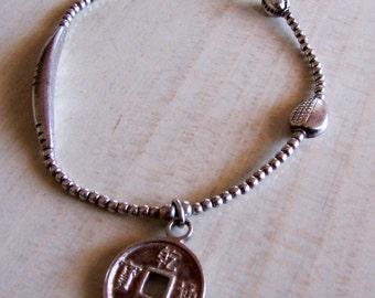 Sterling Silver Bead Bracelet on Stretch Cord