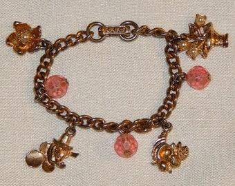 Vintage Charm Bracelet - Leprechaun, Flowers, Cornucopia with Pink Baubles