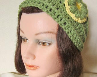 Ladies-Teen Headwrap: the piece is made with a olive green yarn embellished with a olive/yellow flower, which accentuates the piece nicely.