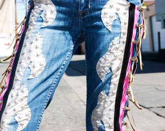 Faux Silver Leather Axe Shape Design Silver Studs Gold Fringe Pink Vinyl Accent on a pair of Vintage Blue Jeans