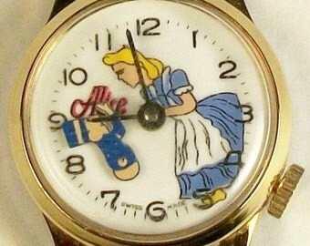 Disney Retired Wind Up Alice In Wonderland Watch W/Mad Hatter! Hatter moves! HTF! No longer Made!