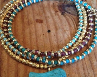 Vermeil nugget bracelet with a native american turquoise bird charm