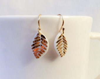 small white porcelain leaf earrings with gold-painted design and hooks