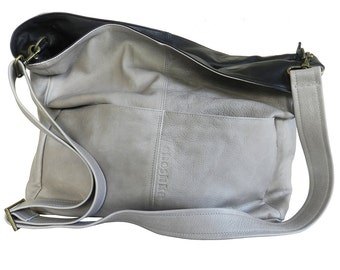 """A """"TEL AVIV"""" folded gray bag. The bag is big enough to contain """"half of our household"""", as some of us like……"""