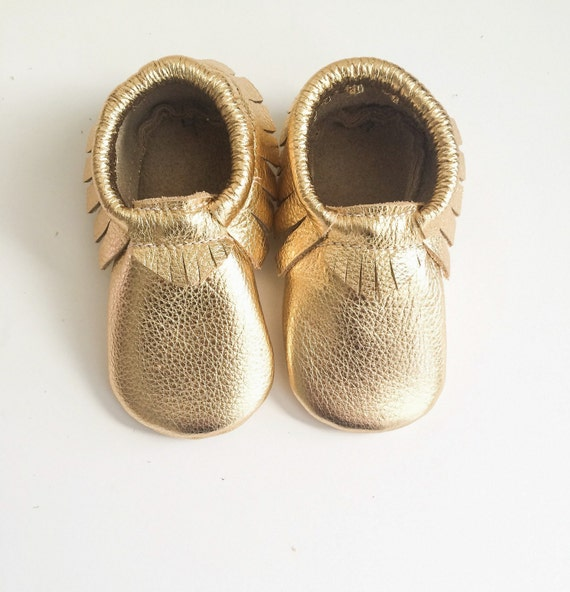 You searched for: gold baby moccasins! Etsy is the home to thousands of handmade, vintage, and one-of-a-kind products and gifts related to your search. No matter what you're looking for or where you are in the world, our global marketplace of sellers can help you .