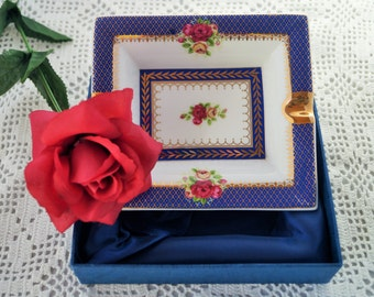 A very striking ash tray with cobalt blue and gold detail. Roses can also be seen in the centre and on two sides. Still in its original box.