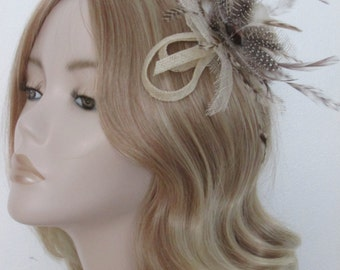 IVORY and BROWN FASCINATOR, Spotted feathers, Flat bead,  Mounted on a clip