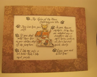 "Paper  Sign / Wall Hanging: "" The Rules of the House Concerning Our Pets"", with 3D dog embellishments, and handwritten calligraphy"