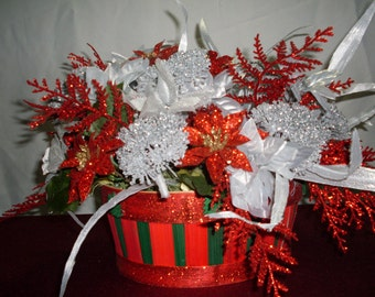 Christmas silk flowers all sparkles and ribbons, colors are mostly red and white with silver tones!