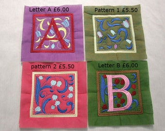 Embroidered Alphabet quilting letters A-J and decorated squares. Ready to quilt with wadding already attached!