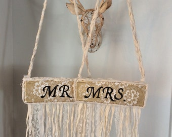 Hanging Mr. and Mrs. Signs