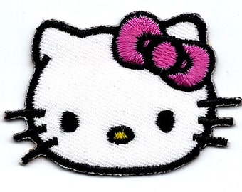 Hello Kitty in hot pink overalls Aloha Hawaiian hibiscus flower Embroidered Iron On / Sew On Patch - Sanrio