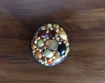 """Vintage, handmade pin brooch made with nuts, seeds, corn and wood - 1"""" in diameter"""