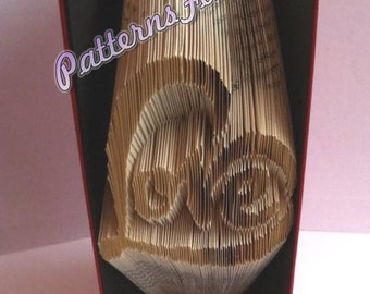Book folding pattern for the word LOVE making a HEART