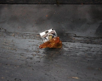 Amber and silver geometric ring.
