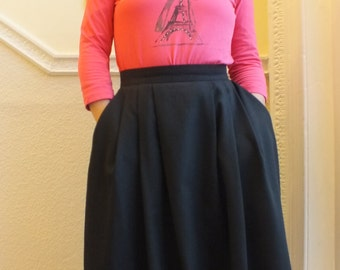 Black vintage 1990s skirt/St. Michael/size 14/slash front pockets/back zipper