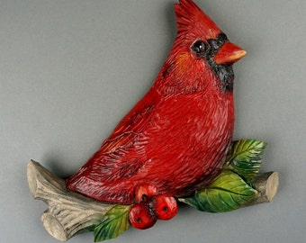 Red Cardinal carved on wood (branch)