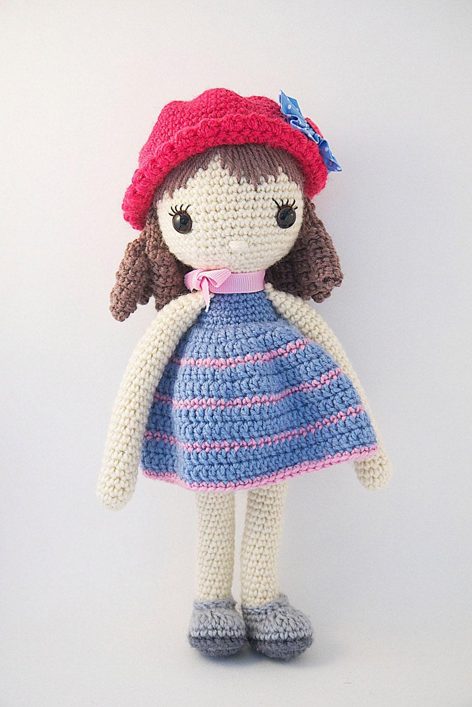 Amigurumi crochet doll Pretty little girl with curls in a