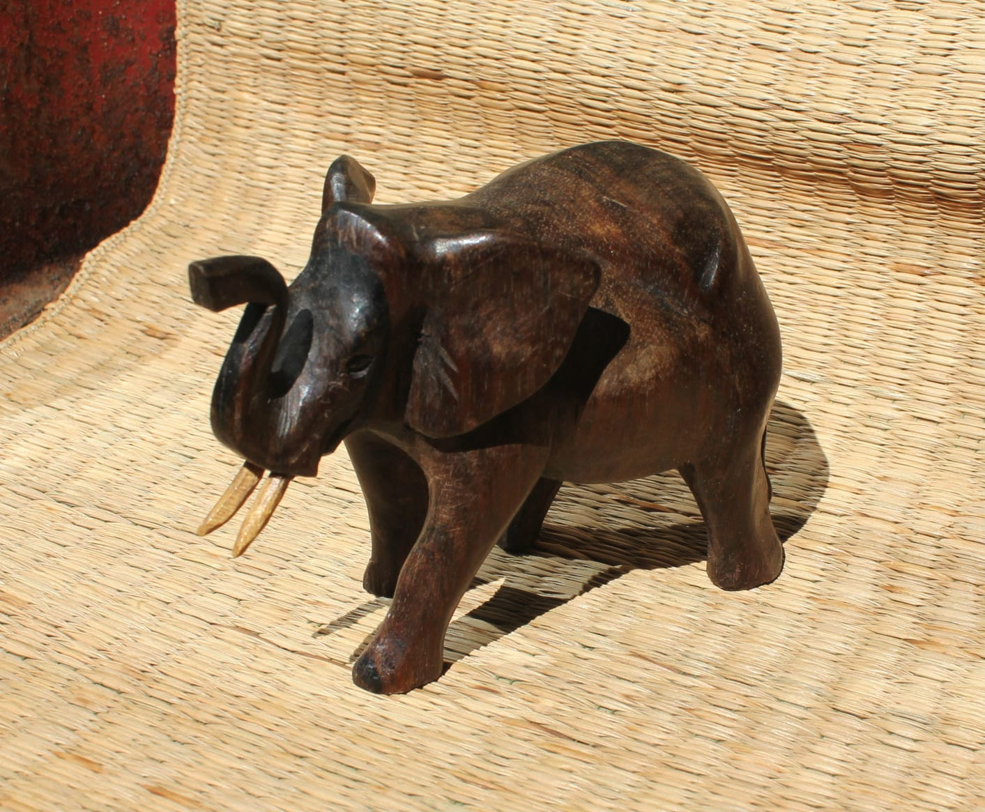 Small hand carved dark wood elephant bali by bellamercantile