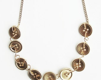 gold button and wire necklace