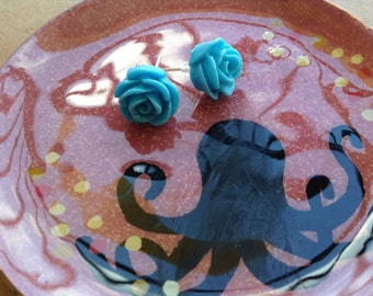 Sparkly blue rose post earrings.