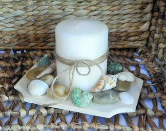 Beach theme candle with seashells and pebbles
