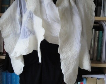 Made to order white Nuno wet felted wedding shawl made with white polwarth wool on white silk chiffon with am X's and O's design.