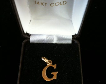 "14 k Yellow Gold ""G"" Initial Charm .80 gm."