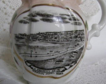 Antique 19th century Victorian pink lustre ware jug.Souvenir of Weston-Super-Mare -black and white picture to front.Pansies (for thoughts)