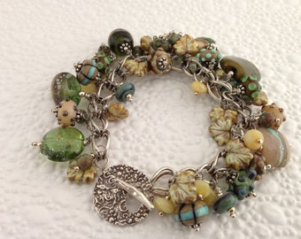 Earthy Greens Lampwork, Fine Silver, and Gemstone Charm Bracelet