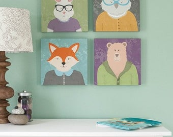 set of 4 canvas prints for children featuring a fox, bunny, bear and owl, perfect for a nursery or kids room, illustrated artwork