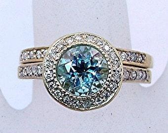 AAAA Aquamarine   7.00mm  1.20 Carats   14K Yellow gold diamond bridal set. B007 0774 MMM