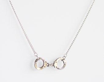 Silver handcuff charm pendant necklace on delicate silver chain