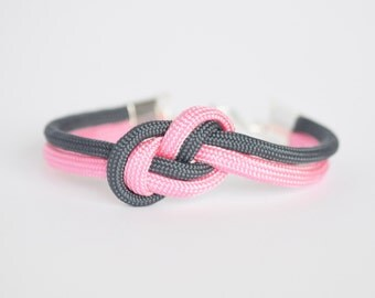 Navy blue and light pink infinity knot parachute cord rope bracelet