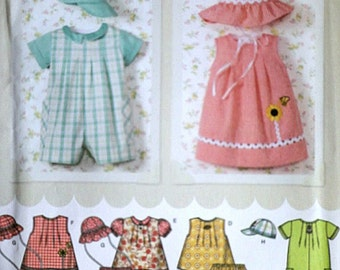 Simplicity 4243 Sewing Pattern, Infants' Romper In Two Lengths, Dress, Top, Panties And Hat, Sizes XXSmall to Large, Uncut Factory Folded